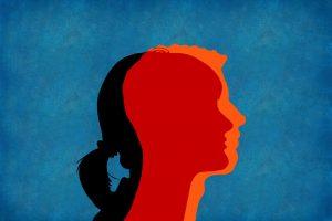 silhouet man en vrouw gezicht door elkaar (transseksualiteit verbeeldend)